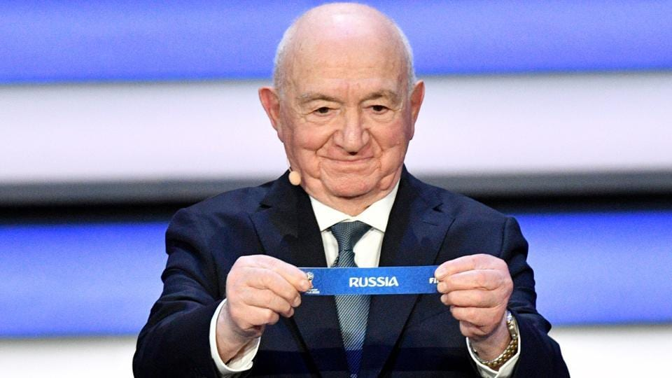 Former USSR forward and coach Nikita Simonyan displays the slip of Russia during the Final Draw for the 2018 FIFA World Cup at the State Kremlin Palace in Moscow on Friday.