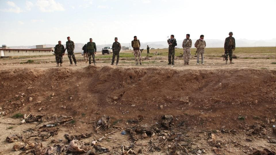 """The Hashed al-Shaabi paramilitary alliance said it had found """"a mass grave with the bodies of 20 women and about 40 children in the village of Kabusi, south of Sinjar."""""""