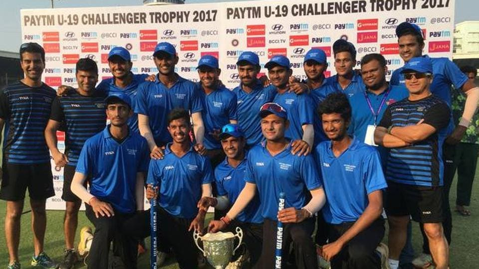 India Blue cricket team with the U-19 Challenger Trophy at the Cricket Club of India (CCI) in Mumbai on Saturday.