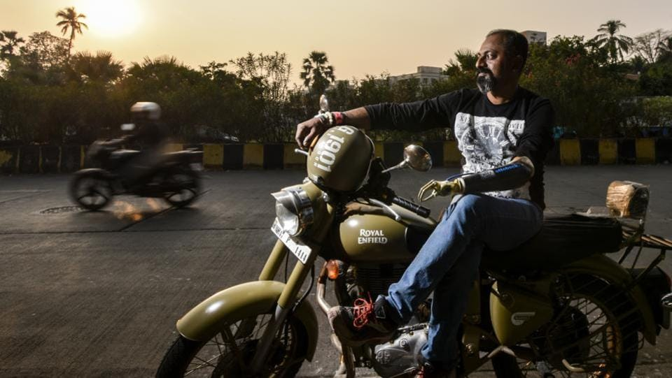 Mahendra Pitale with his bike at Versova, Mumbai. Pitale lost his left hand in the blast at Jogeshwari station in 2006 in Mumbai. Currently employed with the railways, Pitale now rides a Royal Enfield Bullet for various causes using his artificial arm. He joined the bullet club and started cross-country tours, spreading awareness about organ donation and cancer. He also finds time to counsel those impaired by accidents and disease. (Kunal Patil / HT Photo)
