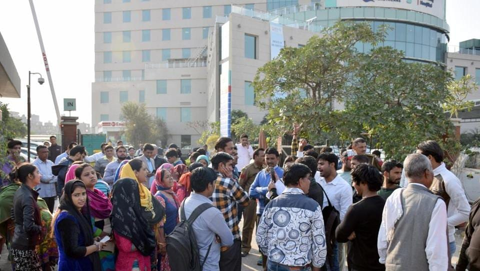 People protest outside Max Hospital, Shalimar Bagh, New Delhi.