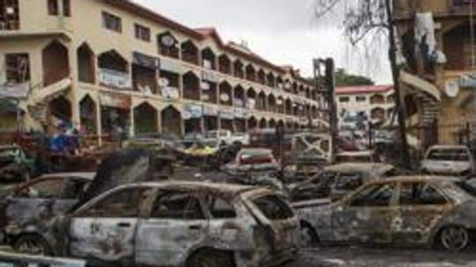 The scene of a bombing at the Emab business centre is pictured filled with wreckages of burnt cars, at the business district in Abuja June 26, 2014.m