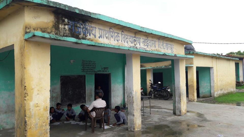 Children at a worn out state-run primary school building at Khanpur in Haridwar.