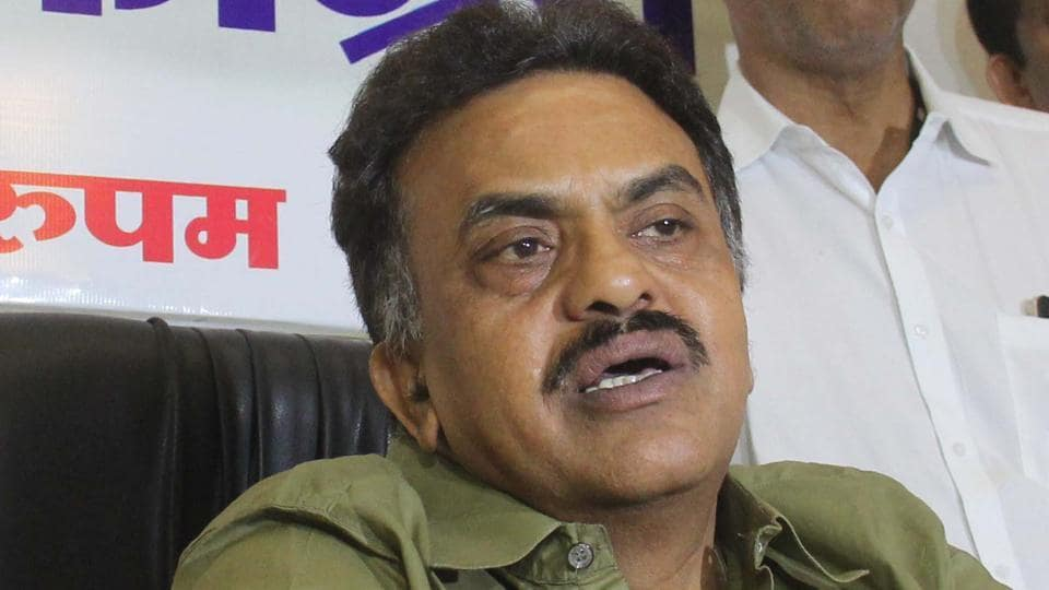 Mumbai Congress President Sanjay Nirupam talks to reporters after the MNS attack on the Mumbai Regional Congress Committee office.