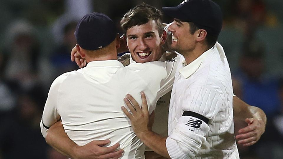 England cricket team's Craig Overton (centre) celebrates with teammates Jonny Bairstow (left) and Alastair Cook after bowling out Australia cricket team skipper Steve Smith during their Ashes 2017-18 second Test in Adelaide on Saturday.