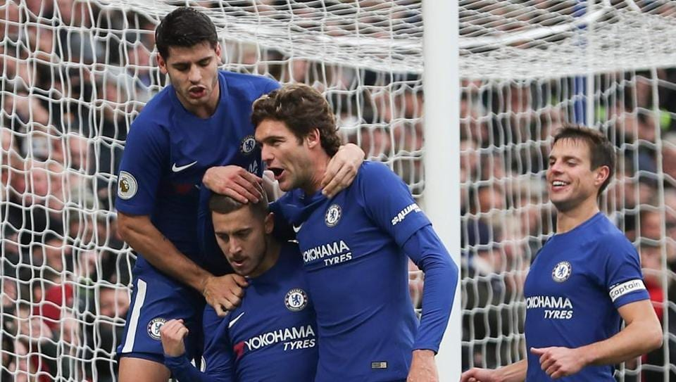 Chelsea's Eden Hazard celebrates with teammates after scoring his team's third goal vs Newcastle United at Stamford Bridge.