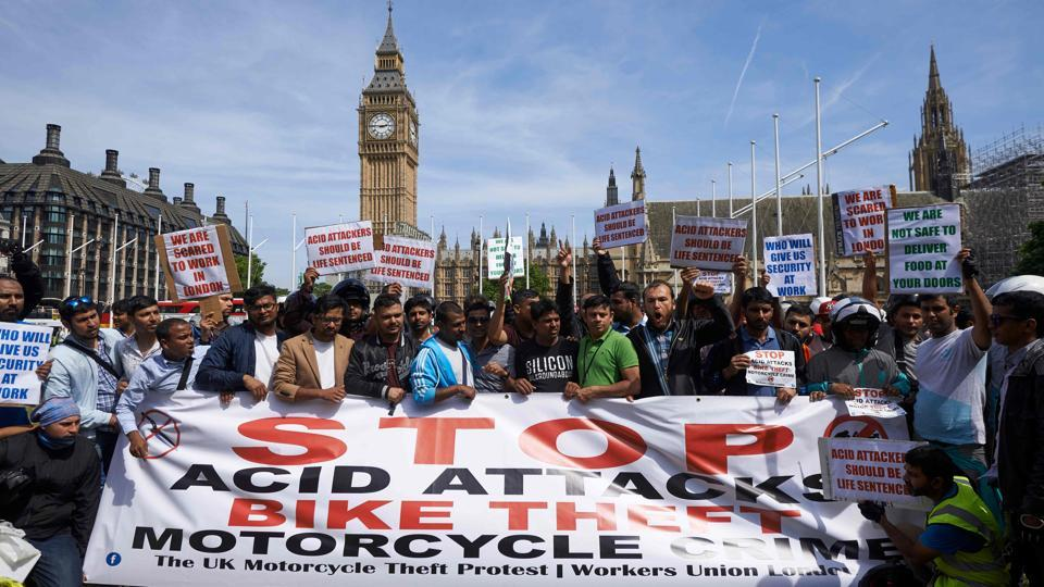 Motorcycle delivery drivers and motorcyclists taking part in a demonstration in Parliament Square in central London on July 18, 2017, following a spate of acid attacks on July 13.