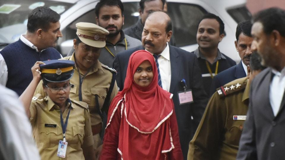 24-year-old Hadiya (in red) at the Supreme Court after a hearing in New Delhi, on November 27, 2017. The Supreme Court on November 27 set her free from the custody of her parents and directed her to pursue studies at the Salem college, appointing its dean as guardian. (Vipin Kumar / HT Photo)