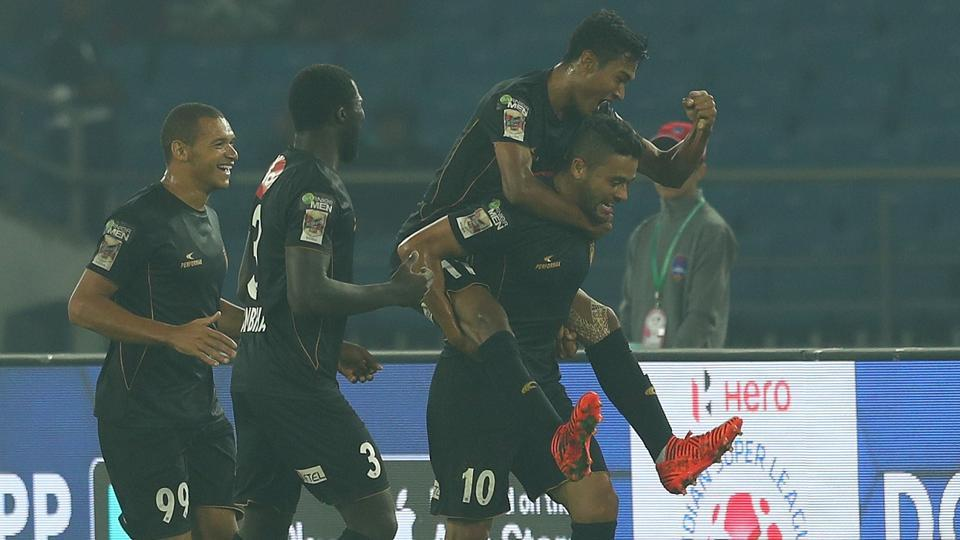 Marcinho (Marcio de Souza) of Northeast United FC celebrates with teammates after scoring for NorthEast United FC in their Indian Super League (ISL)match against Delhi Dynamos FC at the Jawaharlal Nehru Stadium in New Delhi on Saturday. Get highlights of Delhi Dynamos vs NorthEast United FC here.