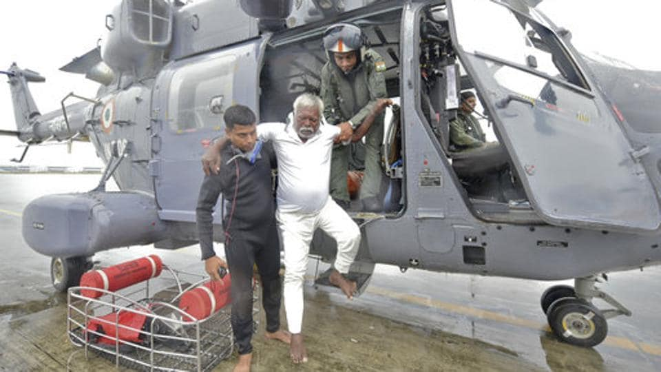 A fisherman who was stranded in the Arabian Sea is escorted from an Indian Navy helicopter after being rescued in Thiruvananthapuram, Kerala on December 01, 2017. At least 200 fishermen marooned at sea were rescued by a joint operation carried out by Navy, Air Force and Coast Guard. A Japanese cargo ship also rescued 60 persons and later handed them to the Coast Guard. (AP)