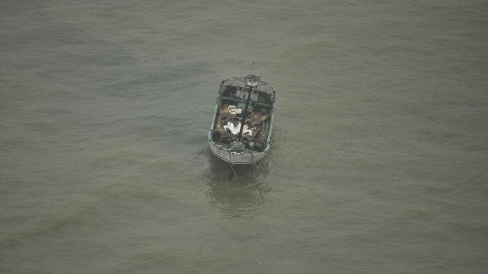 An Indian fishing boat is seen in the Arabian Sea is seen after fishermen were rescued in Thiruvananthapuram, Kerala on Friday, Dec.1, 2017.