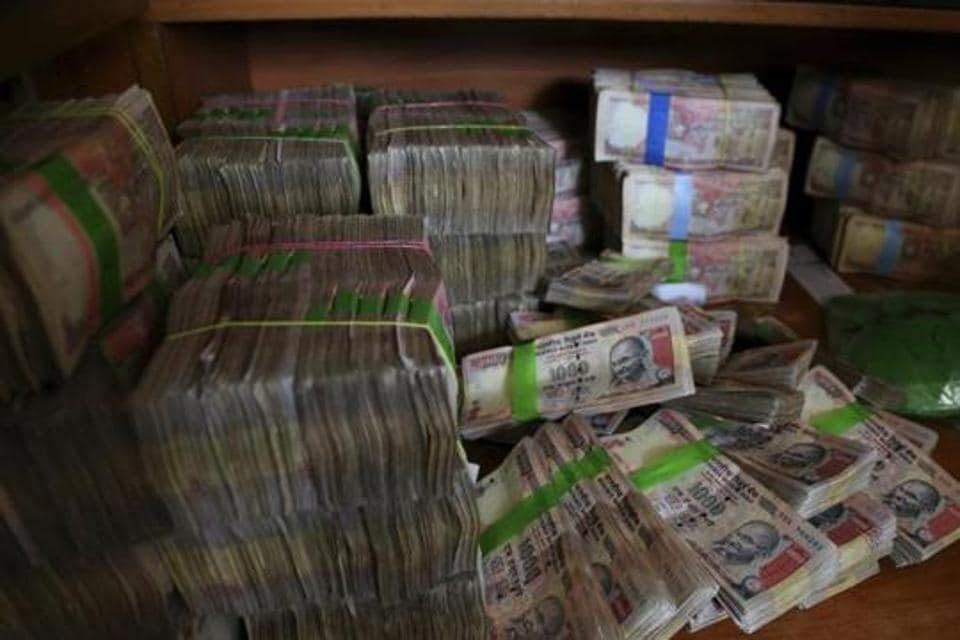 Discontinued currency notes of 1,000 denomination are seen after they were deposited by people at a bank in Bangalore in November 2016.