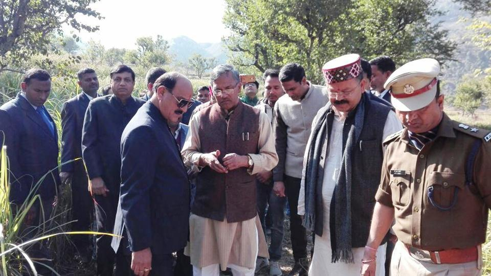 Chief minister Trivendra Singh Rawat interacts with villagers at Jaiharikhal in Pauri.