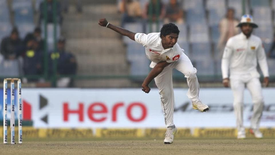 Sri Lanka's Lakshan Sandakan bowls during the first day of their third test cricket match against India in New Delhi, India.