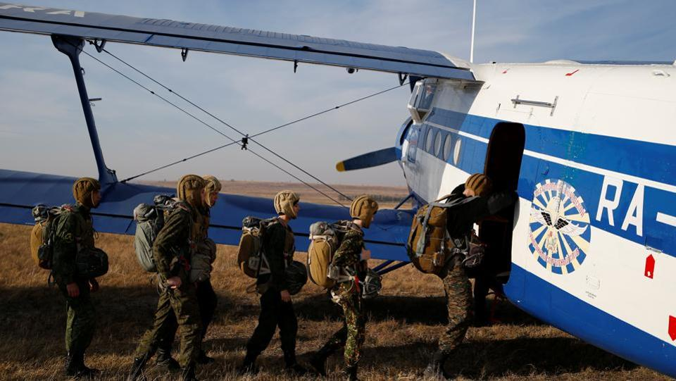 Students from the General Yermolov Cadet School board an airplane for a parachute jump at an airdrome in the village of Novomaryevskaya outside Stavropol. Physical exercises go hand-in-hand with weapons training, marksmanship tests, car driving and even parachuting. (Eduard Korniyenko / REUTERS)