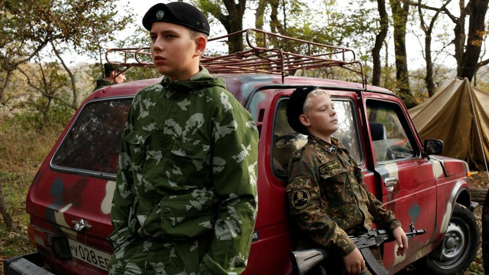 Students from the General Yermolov Cadet School take a break during a tactical exercise on the ground, which includes intrenchment training, forest survival studies and other activities, outside Stavropol. About 40 percent of school attendees here end up joining the military or law enforcement agencies. (Eduard Korniyenko / REUTERS)