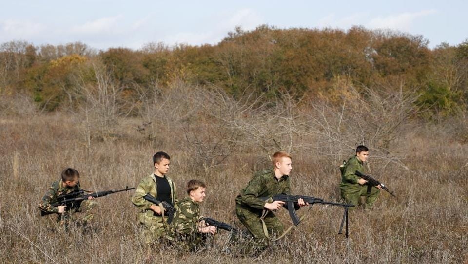 """Students from the General Yermolov Cadet School attend a military tactical exercise outside Stavropol, Russia. President Vladimir Putin may be criticised by the West for the annexation of Crimea from Ukraine in 2014 or """"The Crimean Spring"""" as it was hailed by Russian nationalists, but at home the move has led to an upsurge in what is called """"military and patriotic education"""" of Russian youths. (Eduard Korniyenko / REUTERS)"""
