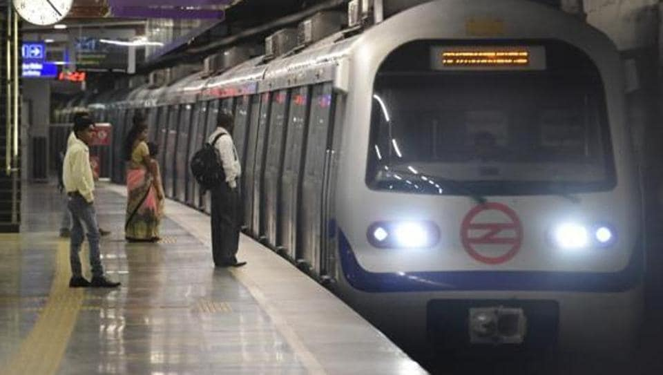 People enjoying first metro ride at ITO to Kashmere Gate section.