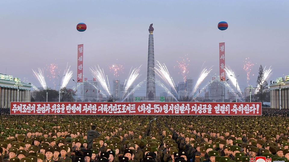 This December 1, 2017 picture released by North Korea's official Korean Central News Agency (KCNA) shows North Korean soldiers and Pyongyang residents holding a rally to celebrate the North's declaration it had achieved full nuclear statehood.