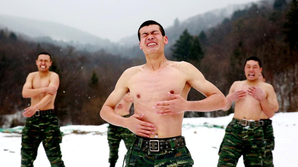 Paramilitary soldiers rub snow onto their bodies in a temperature around negative 25 degrees Celsius (minus 13 degrees Fahrenheit) during a winter training session at a snowfield on November 28, 2017 in Changchun, Jilin province, China. (REUTERS)