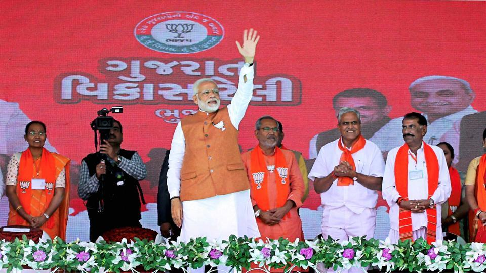 Prime minister Narendra Modi waves at the crowd during a public meeting in support of BJP candidates for Gujarat assembly polls, in Bhuj.