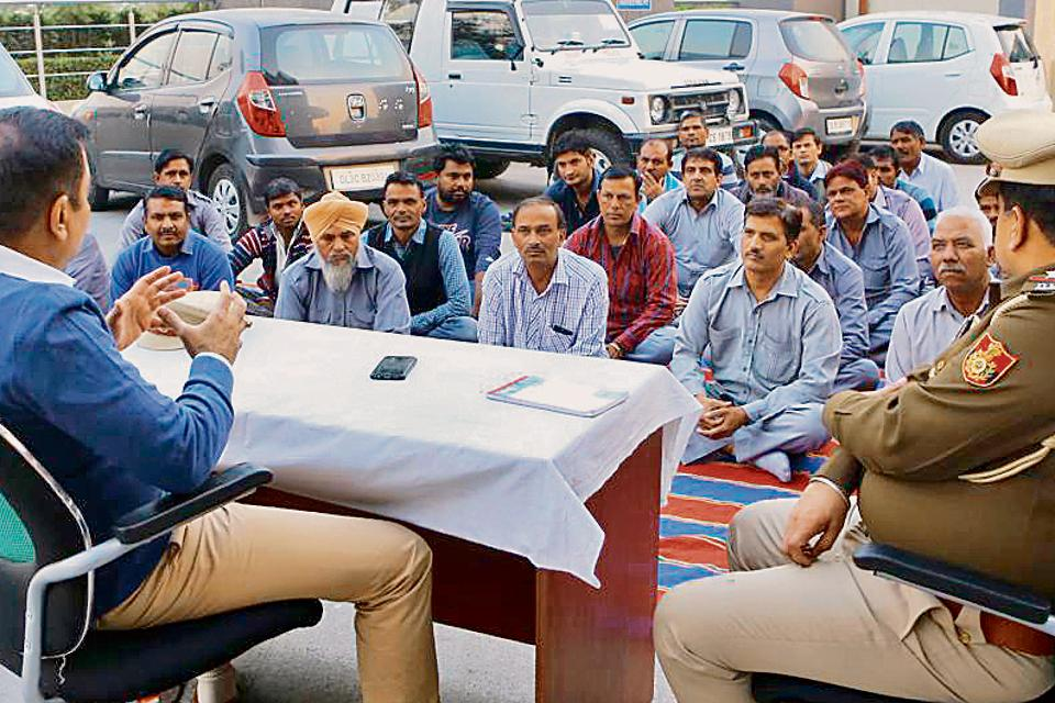 Delhi Police officers impart training to cab drivers near IGI Airport's Terminal 3.