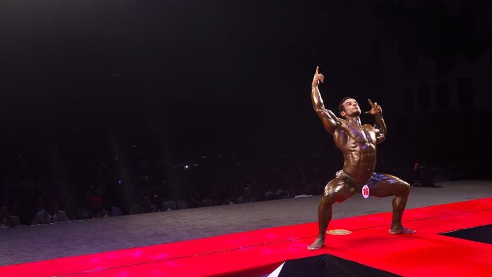 A participant among the final 10 flexes during the