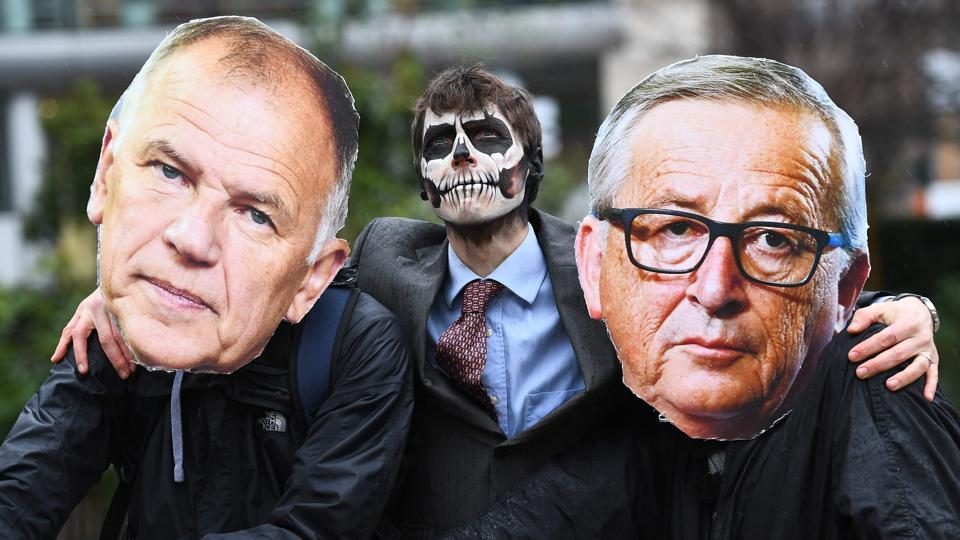 Activists dressed as European Commission President Jean-Claude Juncker (R), EU Commissioner in charge of Health and Food safety Vytenis Andriukaitis (L) and with face painted with a skull enact a tug-of-war against EU citizens during an action calling for the EU Comission to vote against the licence renewal of the chemical glyphosate  in front of the European Commission headquarters on November 27, 2017 in Brussels, Belgium.  (Emmanuel DunandAFP)