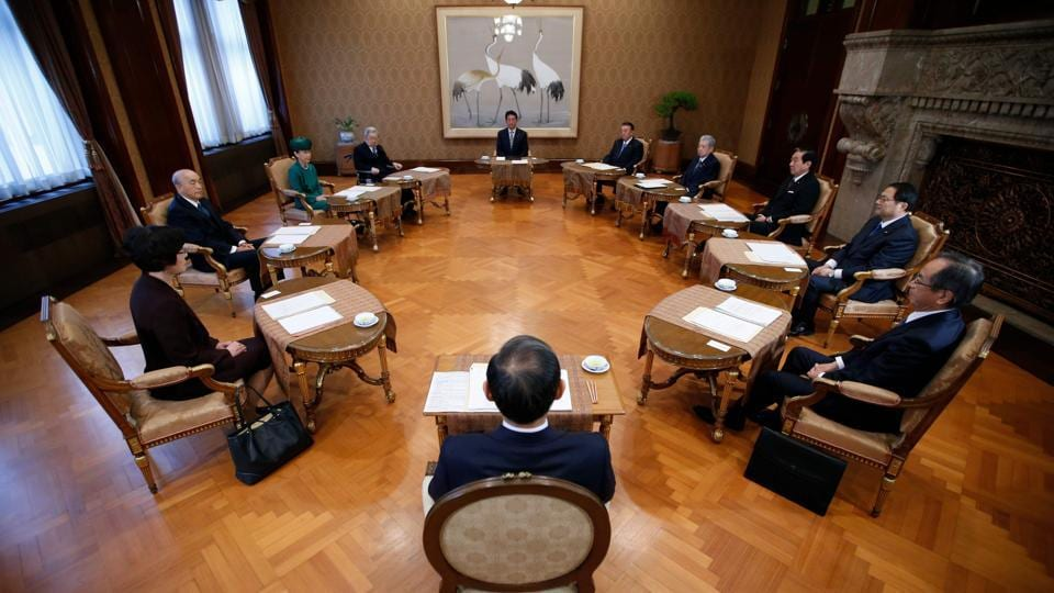 Japan's Prime Minister Shinzo Abe (Top, C),  attends a meeting of the Imperial Household Council to discuss the timeline for the abdication of Japan's Emperor Akihito at the Imperial Household Agency on December 1, 2017 in Tokyo, Japan. (Toru Hanai / AFP)