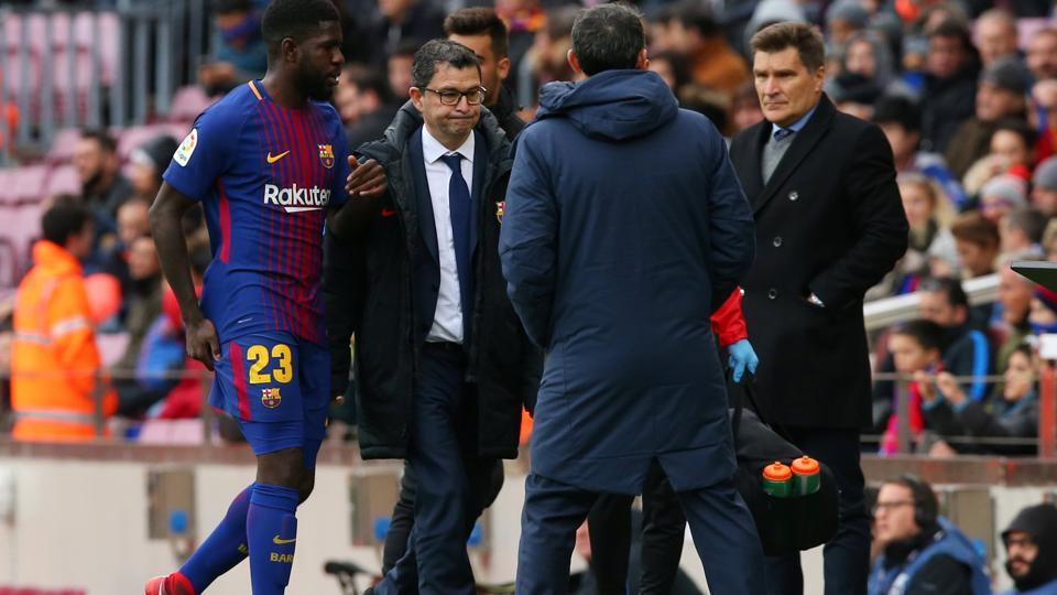 FC Barcelona's Samuel Umtiti leaves the pitch after sustaining an injury during their La Liga encounter.