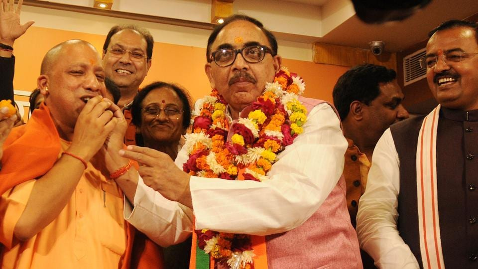 Uttar Pradesh BJP chief Mahendra Nath Pandey offers sweets to chief minister Yogi Adityanath after the party's victory in the civic boy elections in Lucknow on Friday.