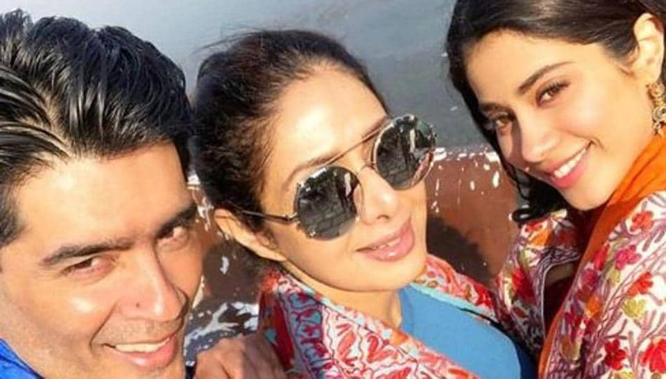 Sridevi poses with her daughter Janhvi and Manish Malhotra.