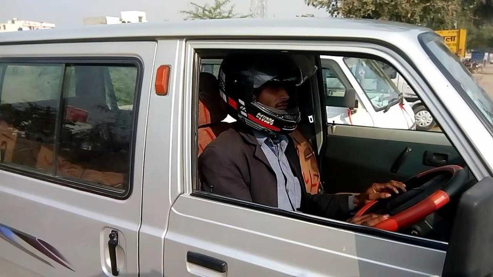 Image result for Once fined, he now wears helmet in a van, Forget seat belts, driving a