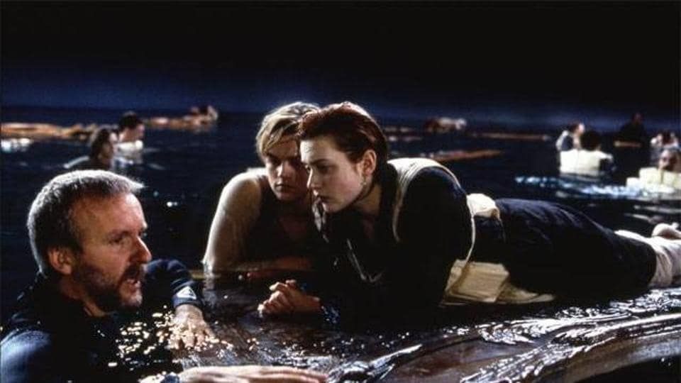 Leonardo DiCaprio and Kate Winslet with James Cameron while shooting for Titanic.