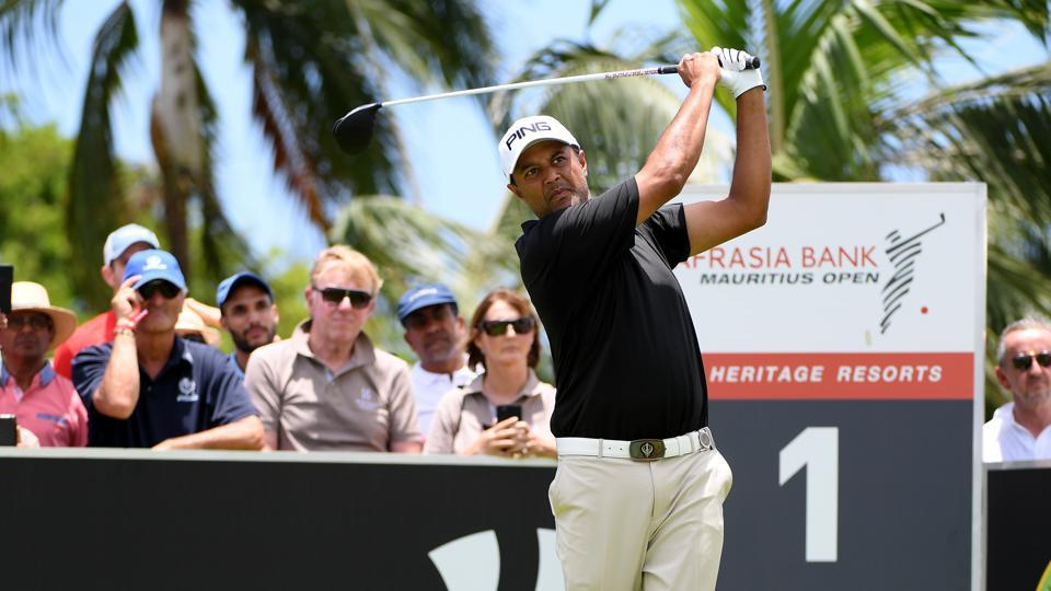Arjun Atwal tees off on the first hole of the final round of the Mauritius Open golf tournament at Heritage Golf Club in Bel Ombre, Mauritius, onSunday.
