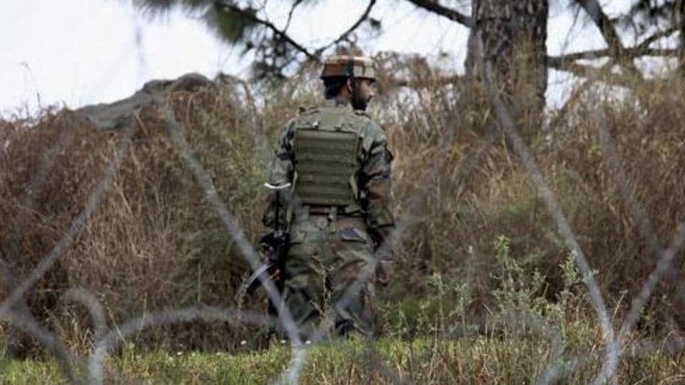 An Indian Army jawan patrolling at the Line of Control (LOC) in Poonch district of Jammu and Kashmir.