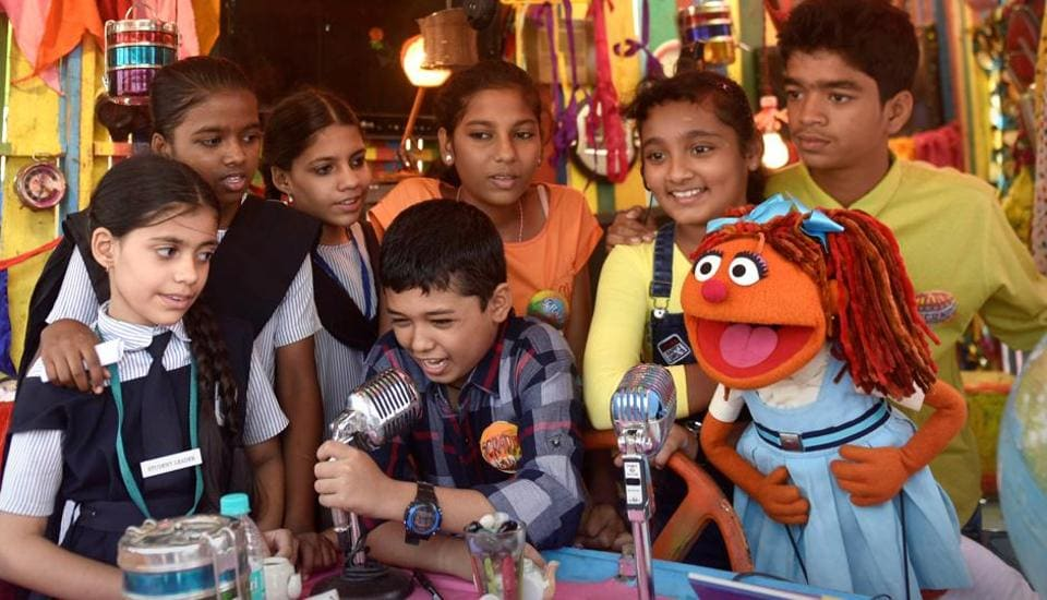 Dheeraj Bhatt, 10,  rehearses with his co-anchor Valeska Jacinto (in yellow), 12,  as city reporters crowd around. They report on everything from sanitation, climate change and waste segregation to how to help out your not-so-tech-savvy grandparents.