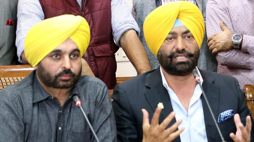 Sukhpal Khaira (right) and state AAP chief Bhagwant Mann at a press conference in Chandigarh on Saturday.