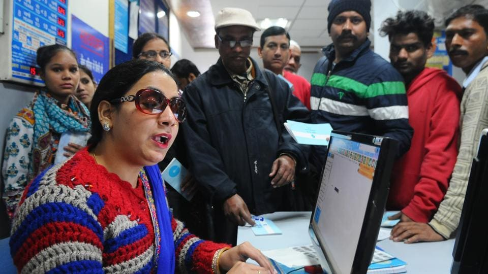 Asma Ali attending customers at the Sector-7 branch of the State Bank of India on Saturday.