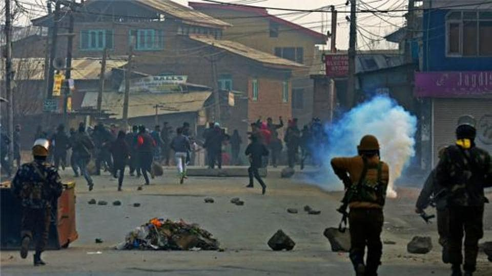 Police fire teargas shells as they chase away stone-pelting mob during a clash at Batmaloo in Srinagar.