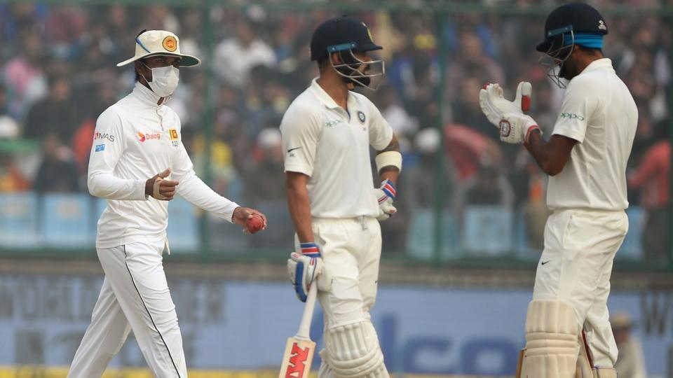 Sri Lanka cricket team captain Dinesh Chandimal (L) wears a mask in an attempt to protect himself. (AFP)