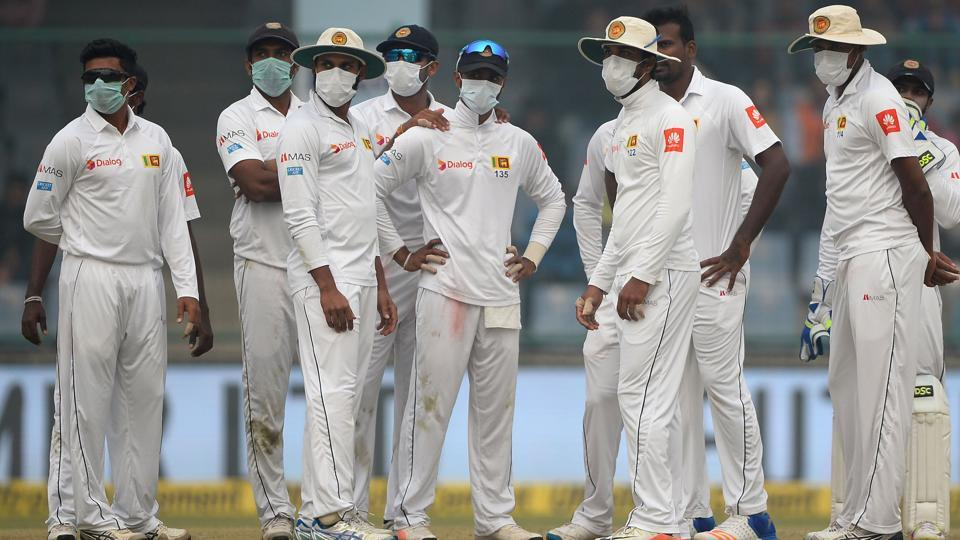 Sri Lanka cricket players wear masks in an attempt to protect themselves from air pollution on Day 2 of Delhi Test. (AFP)