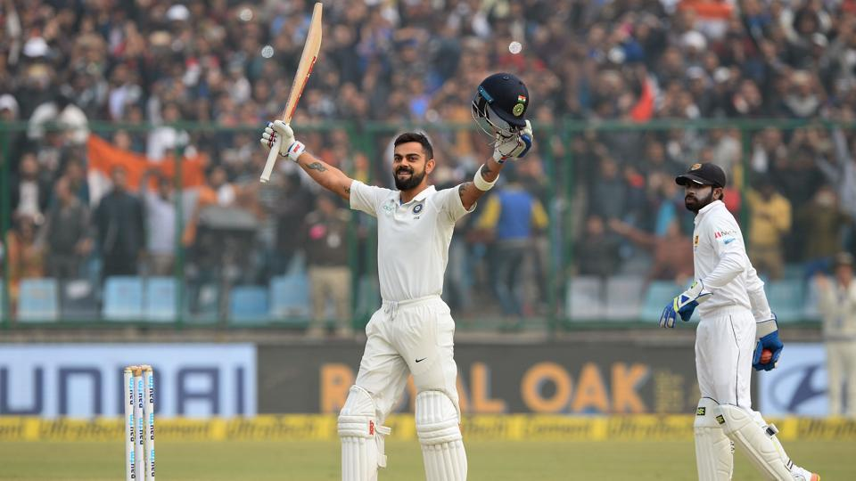 Virat Kohli raises his bat after completing his double century during the second day of the third Test match between India and Sri Lanka at the Feroz Shah Kotla Cricket Stadium in New Delhi on Sunday.