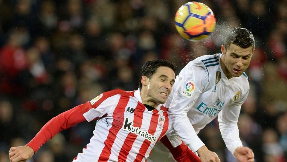 Real Madrid's Cristiano Ronaldo (R) heads the ball with Athletic Bilbao'sXabier Etxeita during La Ligaat the San Mames Stadium in Bilbao on Saturday.