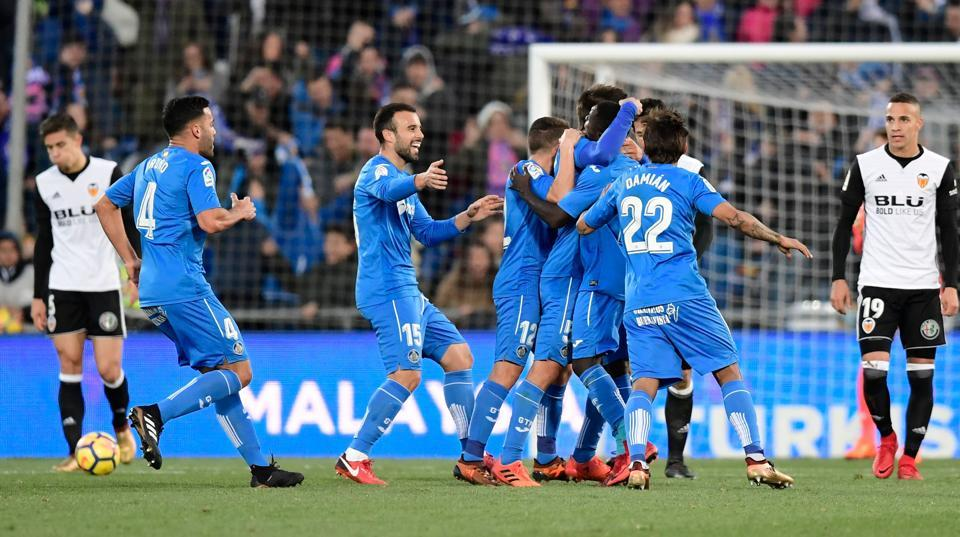 Getafe players celebrate after scoring against Valencia CF during their Spanish La Liga match at the Col. Alfonso Perez stadium in Getafe on Sunday.
