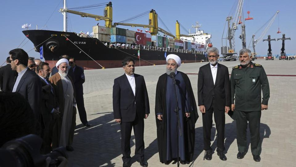 Iranian President Hassan Rouhani, center, speaks during the inauguration of a newly-built extension of the port of Chabahar, near the Pakistani border, on the Gulf of Oman, in Iran, on Sunday.