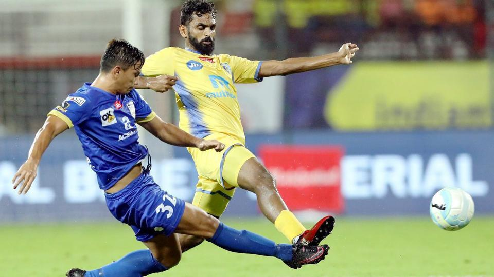 CK Vineeth of Kerala Blasters FC and Davinder Singh of Mumbai City FC vie for the ball during their Indian Super League (ISL) match at the Jawaharlal Nehru Stadium in Kochi on Sunday.