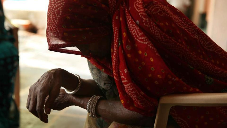 Woman breaks down while narrating her wait for justice against those who branded her a witch, at Bhilwara district, Rajasthan, India on June 1, 2016.