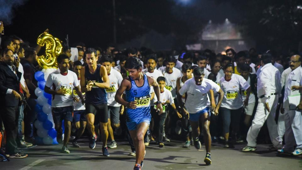 Ethiopia's Getachew Besha clocked 2 hours 15.15s to finish first position while Zelalem Lema Dlema, another Ethiopian, clocked 2 hours 15.31s to grab the second position at the Pune International Marathon held on Sunday in the city.   (Sanket Wankhade/HT PHOTO)