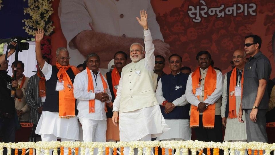 Prime Minister Narendra Modi  waves on his arrival to address a rally at Surendranagar, some 130 kms from Ahmedabad on December 3.